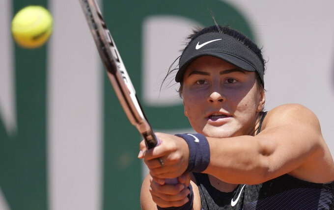 Canada's Bianca Andreescu plays a return to Slovenia's Tamara Zidansek during their first round match on day two of the French Open tennis tournament at Roland Garros in Paris, France, Monday, May 31, 2021. (AP Photo/Christophe Ena)
