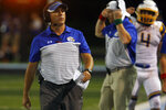 In this Aug. 30, 2019 photo, Olentangy head coach Mark Solis walks down the sideline during a high school football game against Hilliard Darby in Hilliard, Ohio. The percentage of players competing at the NCAA's highest level of college football who are from Ohio has slipped from 5.9% in 2013 to 5.1% in 2018, according to NCAA research. That's still good enough to be fifth-most among the 50 states, but fourth-place Georgia has pulled away and states such as Louisiana (sixth) and Alabama (eighth) have gained on Ohio over the last 10 years. (Shane Flanigan/The Columbus Dispatch via AP)