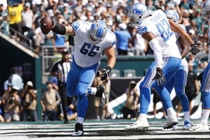 Detroit Lions' Joe Dahl spikes the ball after a touchdown by Kerryon Johnson during the first half of an NFL football game against the Philadelphia Eagles, Sunday, Sept. 22, 2019, in Philadelphia. (AP Photo/Michael Perez)