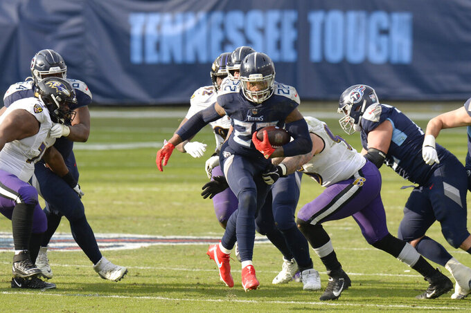 Tennessee Titans running back Derrick Henry (22) carries the ball against the Baltimore Ravens in the second half of an NFL wild-card playoff football game Sunday, Jan. 10, 2021, in Nashville, Tenn. (AP Photo/Mark Zaleski)