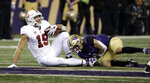 Stanford's JJ Arcega-Whiteside (19) is tackled by Washington's Byron Murphy after a pass reception during the first half of an NCAA college football game Saturday, Nov. 3, 2018, in Seattle. Arecga-Whiteside left the game with an injury. (AP Photo/Elaine Thompson)