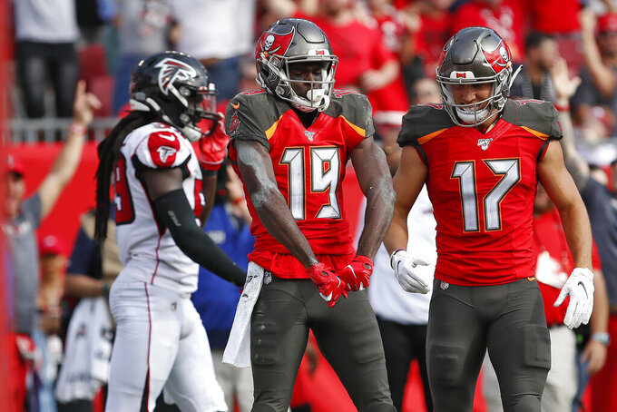 Tampa Bay Buccaneers wide receiver Breshad Perriman (19) celebrates with wide receiver Justin Watson (17) after Perriman caught a 24-yard touchdown reception against the Atlanta Falcons during the first half of an NFL football game Sunday, Dec. 29, 2019, in Tampa, Fla. (AP Photo/Mark LoMoglio)