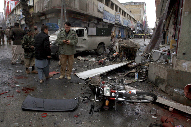 Pakistani police officers examine the site of a bomb explosion in Quetta, Pakistan, Tuesday, Jan. 7, 2020. A powerful roadside bomb exploded near a vehicle carrying Pakistani security forces in the country's southwest, killing soldiers and wounded others, a police official said. (AP Photo/Arshad Butt)