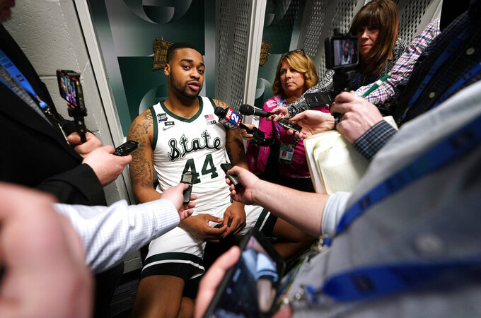 Michigan State forward Nick Ward (44) speaks to reporters in the locker room after a semifinal round game against Texas Tech in the Final Four NCAA college basketball tournament, Saturday, April 6, 2019, in Minneapolis. (AP Photo/David J. Phillip)