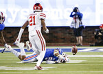SMU running back Xavier Jones (5) fumbles the ball as Houston defensive back Gleson Sprewell (21) defends during the first half of an NCAA college football game, Saturday, Nov. 3, 2018, in Dallas. Sprewell collected the fumble and returned it for a touchdown. (AP Photo/Brandon Wade)