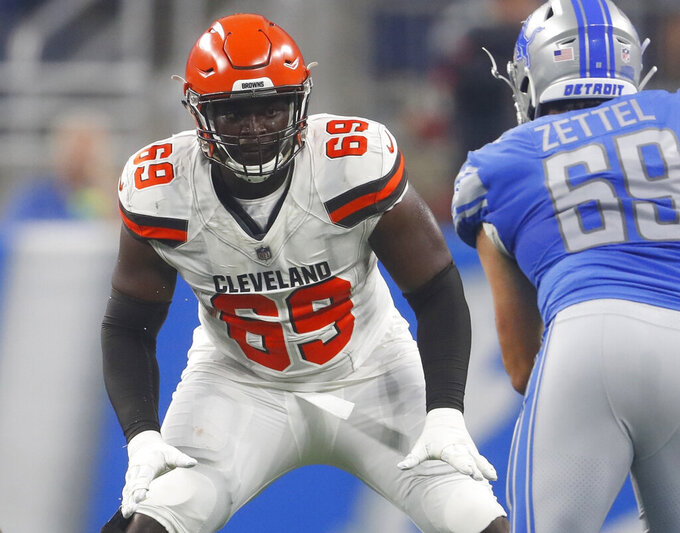FILE - In this Aug. 30, 2018, file photo, Cleveland Browns offensive tackle Desmond Harrison (69) defends the line as Detroit Lions defensive end Anthony Zettel (69) rushes during the first half of an NFL football preseason game in Detroit. Arizona Cardinals' Harrison who was released this week has surrendered to police in North Carolina after a warrant was issued for his arrest on an assault charge. A news release from the Greensboro Police Department says Harrison turned himself in to authorities Friday, July 19, 2019. Harrison was claimed last month by the Cardinals after he was cut by the Browns. (AP Photo/Paul Sancya, File)