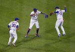 New York Mets' Michael Conforto (30), Keon Broxton (23) and Juan Lagares (12) celebrate after the team's 4-1 win in a baseball game against the Miami Marlins on Saturday, May 11, 2019, in New York. (AP Photo/Frank Franklin II)