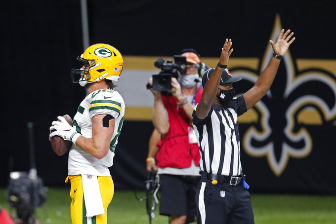Green Bay Packers tight end Robert Tonyan (85) reacts after a touchdown reception in the second half of an NFL football game against the New Orleans Saints in New Orleans, Sunday, Sept. 27, 2020. (AP Photo/Brett Duke)