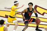 Oregon State guard Gianni Hunt (0) looks to pass as Arizona State guard Jaelen House (10) defends during the first half of an NCAA College basketball game, Sunday, Feb. 14, 2021, in Tempe, Ariz. (AP Photo/Matt York)