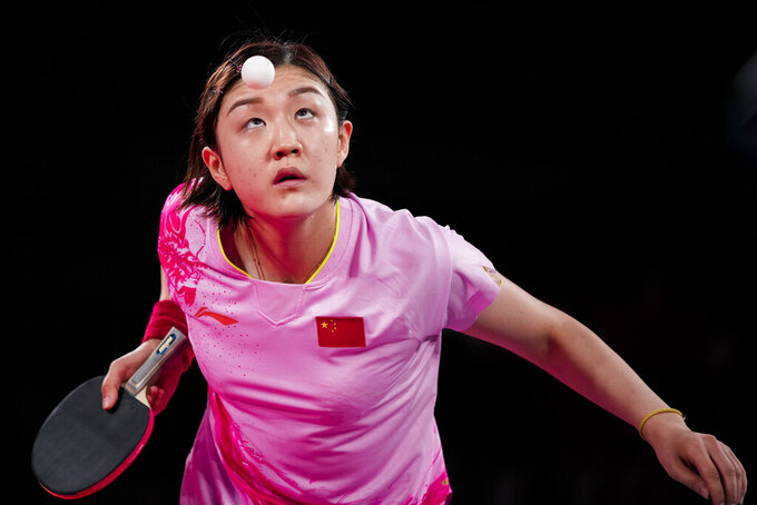 China's Chen Meng competes against Singapore's Yu Mengyu during the table tennis women's singles semifinal at the 2020 Summer Olympics, Thursday, July 29, 2021, in Tokyo. (AP Photo/Kin Cheung)
