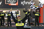 Austin Cindric celebrates in Victory Lane after winning the season championship and a NASCAR Xfinity Series auto race at Phoenix Raceway, Saturday, Nov. 7, 2020, in Avondale, Ariz. (AP Photo/Ralph Freso)