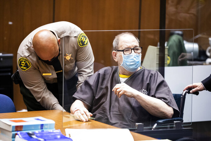 Harvey Weinstein, the 69-year-old convicted rapist and disgraced movie mogul, wears a face mask behind a protective plexiglass screen, as he listens in court during a pre-trial hearing in Los Angeles, Thursday, 29 July 2021. Weinstein pleaded not guilty Wednesday to four counts of rape and seven other sexual assault counts in California.(Etienne Laurent/Pool Photo via AP)