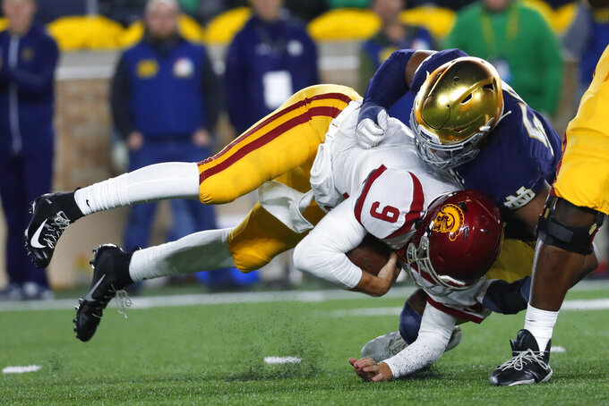 Notre Dame defensive lineman Khalid Kareem (53) sacks Southern California quarterback Kedon Slovis (9) in the first half of an NCAA college football game in South Bend, Ind., Saturday, Oct. 12, 2019. (AP Photo/Paul Sancya)
