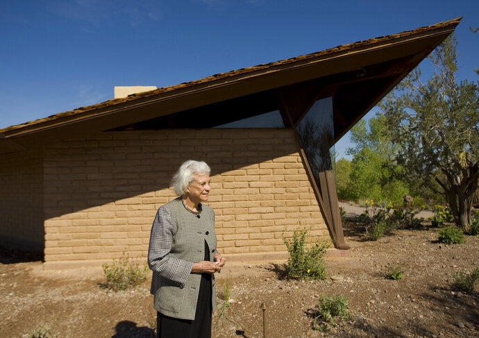 FILE - In this March 1, 2010 file photo,  retired Supreme Court Justice Sandra Day O'Connor stands in front of her 1958 adobe home that was moved and restored at the Arizona Historical Society Museum in Tempe, Ariz. O'Connor's 1950s adobe home in metro Phoenix is being listed on the National Register of Historic Places. The State Historic Preservation Office's announcement Friday, July 19, 2019,  says the National Park Service approved Arizona's nomination of the Sandra Day O'Connor House for placement on the register, which the office described as the nation's list of properties considered worthy of preservation. (David Wallace/The Arizona Republic via AP)