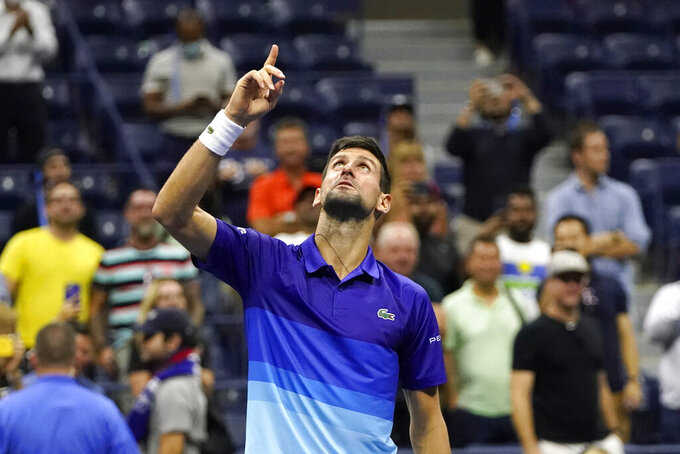 Novak Djokovic, of Serbia, motions and looks up after defeating Matteo Berrettini, of Italy, during the quarterfinals of the U.S. Open tennis tournament Thursday, Sept. 9, 2021, in New York. (AP Photo/Frank Franklin II)
