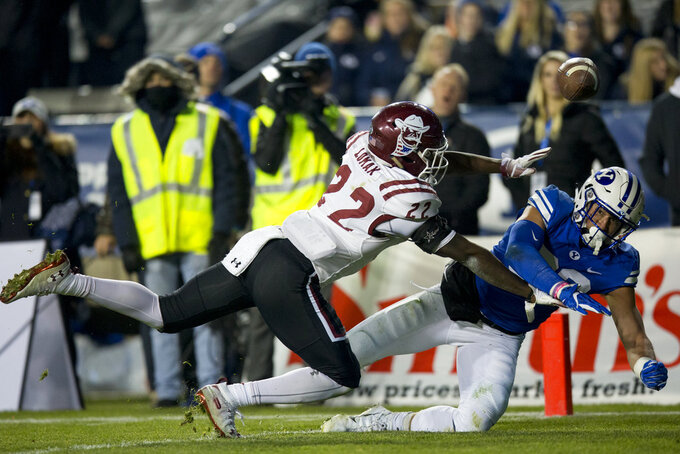 New Mexico State defensive back Shamad Lomax (22) breaks up a pass intended for BYU tight end Dallin Holker (32) in the end zone during an NCAA college football game Saturday, Nov. 17, 2018, in Provo, Utah. (Isaac Hale/Daily Herald via AP)