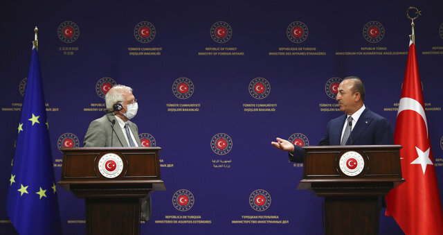 Turkey's Foreign Minister Mevlut Cavusoglu, right, and Josep Borrell Fontelles, High Representative and Vice-President of the European Commission, speak during a joint news conference, in Ankara, Turkey, Monday, July 6, 2020. Turkey's Foreign Minister on Monday called on the European Union to be an