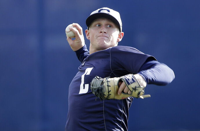 In this March 6, 2019, photo, California's Andrew Vaughn throws a ball during baseball practice in Berkeley, Calif. Vaughn began his junior season insistent he had no plans of figuring out a way to top his sensational sophomore season for California. That would be an overwhelming process considering he had among the best years in college baseball.  (AP Photo/Jeff Chiu)