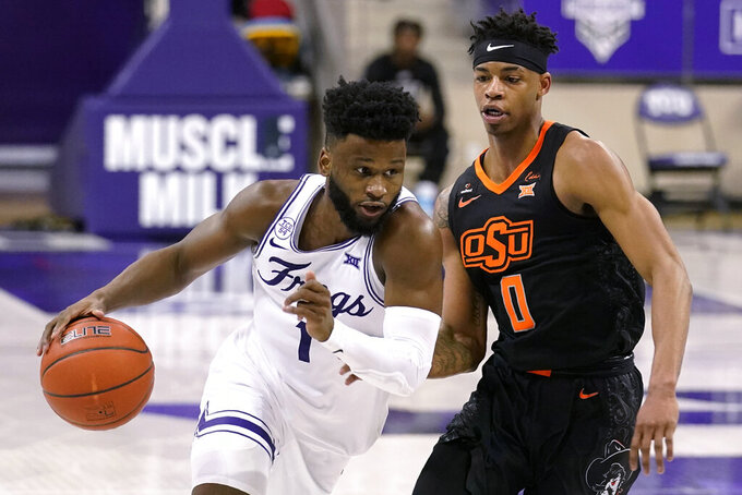 TCU guard Mike Miles (1) sprints to the basket past Oklahoma State guard Avery Anderson III (0) during the second half of an NCAA college basketball game in Fort Worth, Texas, Wednesday, Feb. 3, 2021. (AP Photo/Tony Gutierrez)