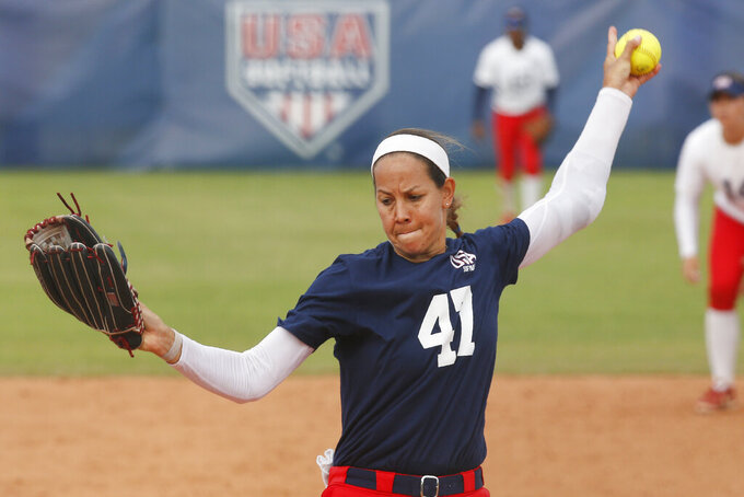 FILE - In this Oct. 5, 2019, file photo, Cat Osterman pitches during a simulated game at the USA Softball Women's Olympic Team Selection Trials in Oklahoma City. Osterman says she will retire from the sport this year. The left-handed pitcher will represent Team USA at the Olympics before defending the Athletes Unlimited title she won last season at age 37. She surprised herself by claiming the Athletes Unlimited title and takes added confidence into her run at a second Olympic gold medal. (AP Photo/Sue Ogrocki, File)