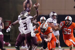 Missouri State quarterback Jason Shelley (3) passes under pressure from Oklahoma State linebacker Malcolm Rodriguez (20) in the second half of an NCAA college football game, Saturday, Sept. 4, 2021, in Stillwater, Okla. (AP Photo/Sue Ogrocki)