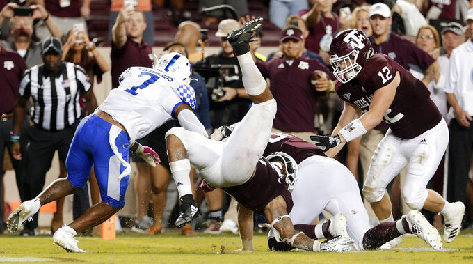 Texas A&M outlasts No. 13 Kentucky 20-14 in OT