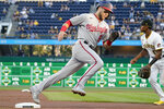 Washington Nationals' Carter Kieboom dashes around third and Pittsburgh Pirates third baseman Ke'Bryan Hayes on his way to score on a triple by Riley Adams during the second inning of a baseball game Friday, Sept. 10, 2021, in Pittsburgh. (AP Photo/Keith Srakocic)