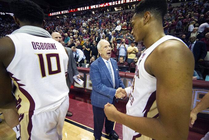 North Carolina head coach Roy Williams congratulates Florida State guard Devin Vassell (24) after Florida State defeated North Carolina 65-59 in an NCAA college basketball game in Tallahassee, Fla., Monday, Feb. 3, 2020. (AP Photo/Mark Wallheiser)