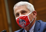 FILE - In this July 31, 2020 file photo, Dr. Anthony Fauci, director of the National Institute for Allergy and Infectious Diseases, testifies during a House Subcommittee hearing on the Coronavirus crisis, on Capitol Hill in Washington. (Kevin Dietsch/Pool via AP)