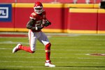 Kansas City Chiefs running back Le'Veon Bell (26) gains yardage after catching a pass in the first half of an NFL football game against the New York Jets on Sunday, Nov. 1, 2020, in Kansas City, Mo. (AP Photo/Jeff Roberson)