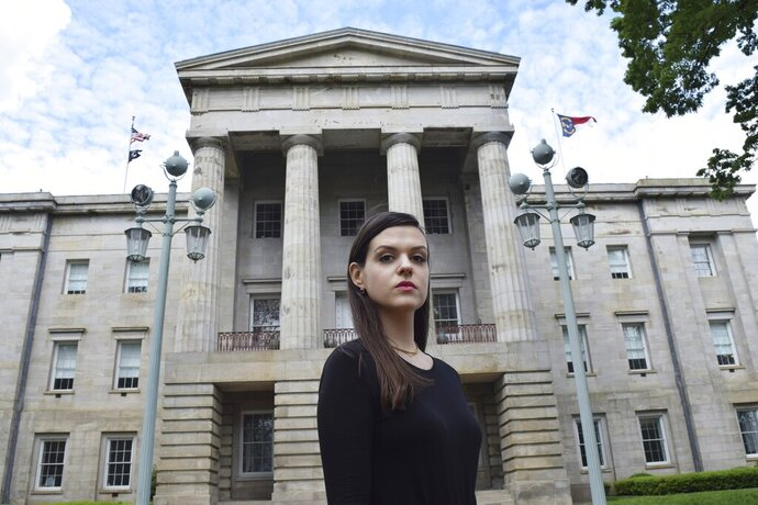 In this April 25, 2019, photo, North Carolina resident Leah McGuirk poses for a photo in Raleigh, N.C. McGuirk is an advocate for a bill that would make it illegal to tamper with someone's drink and would close other loopholes in the state's sexual assault laws. McGuirk experienced a seizure after one of her drinks was drugged in May 2018. (AP Photo/Amanda Morris)