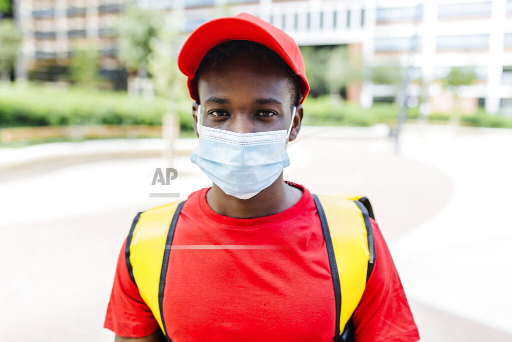 Delivery man wearing protective face mask during pandemic