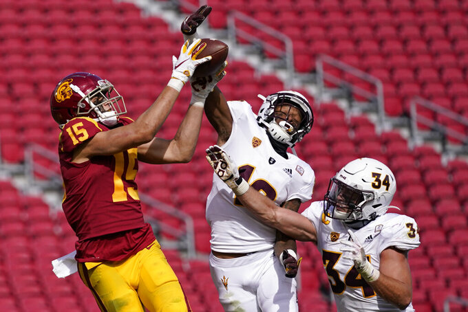 Southern California wide receiver Drake London (15) catches a pass in the end zone for a touchdown as Arizona State defensive back Kejuan Markham (12) and linebacker Kyle Soelle (34) defend during the second half of an NCAA college football game Saturday, Nov. 7, 2020, in Los Angeles. USC won 28-27. (AP Photo/Ashley Landis)