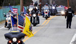 Patriot Guard Riders lead the procession with the family as they arrive for a memorial service for U.S. Air Force Staff Sgt. Dylan J. Elchin on Thursday, Dec. 6, 2018 in Moon Township, Pa. Elchin was one of three servicemen killed last month when their vehicle was destroyed by an improvised explosive device in Andar, in Afghanistan's Ghazni Province. (AP Photo/Keith Srakocic)