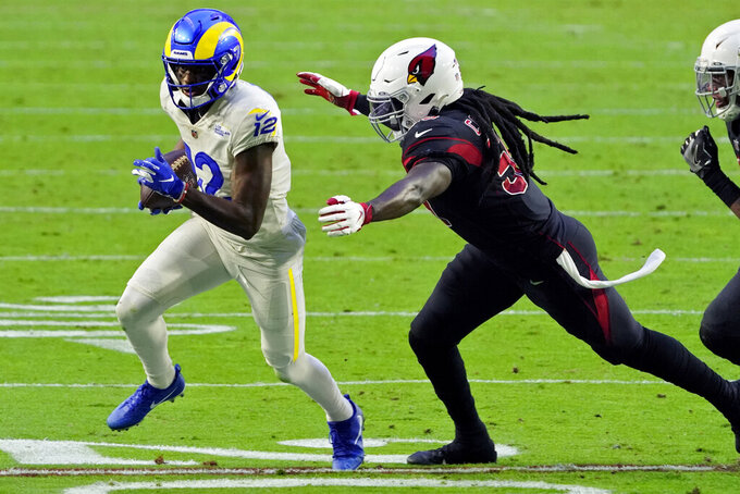 Los Angeles Rams wide receiver Van Jefferson (12) tries to elude Arizona Cardinals outside linebacker De'Vondre Campbell during the second half of an NFL football game, Sunday, Dec. 6, 2020, in Glendale, Ariz. (AP Photo/Rick Scuteri)