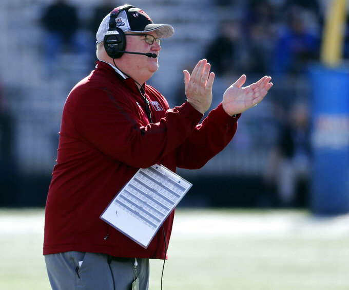Temple head coach Ed Foley cheers his players on against Duke during the first half of the Independence Bowl, an NCAA college football game against Temple, in Shreveport, La., Thursday, Dec. 27, 2018. Duke won 56-27. (AP Photo/Rogelio V. Solis)