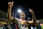Catalans Dragons Israel Folau gestures to the crowd after the Super League rugby match between Catalans Dragons and Castleford Tigers at Stade Gilbert Brutus in Perpignan, France, Saturday, Feb. 15, 2020. (AP Photo/Joan Monfort)