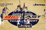 Seton Hall's Ike Obiagu (21) and St. John's Josh Roberts (1) vie for the opening tip-off in the first half of an NCAA college basketball game in the quarterfinals of the Big East conference tournament, Thursday, March 11, 2021, in New York. (AP Photo/Mary Altaffer)