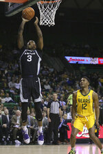 Kansas State guard DaJuan Gordon (3) scores against Baylor guard Jared Butler (12) in the first half of an NCAA college basketball game, Tuesday, Feb. 25, 2020, in Waco, Texas. (AP Photo/ Jerry Larson)