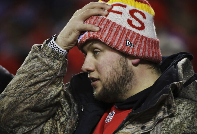 Kansas City Chiefs fan reacts during the first half of the AFC Championship NFL football game between the Kansas City Chiefs and the New England Patriots, Sunday, Jan. 20, 2019, in Kansas City, Mo. (AP Photo/Elise Amendola)