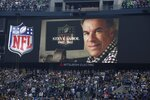"""FILE - In this Sept. 24, 2012, file photo, a tribute to NFL Films' Steve Sabol is shown during an NFL football game between the Green Bay Packers and the Seattle Seahawks in Seattle. """"Hard Knocks,"""" which started 20 years ago, is one of Steve Sabol's many legacies at NFL Films that continue to live on. Sabol, who was 69 when he died from brain cancer in 2012, is one of three contributors that are part of the Hall's 2020 Centennial Class. (AP Photo/Ted S. Warren, File)"""