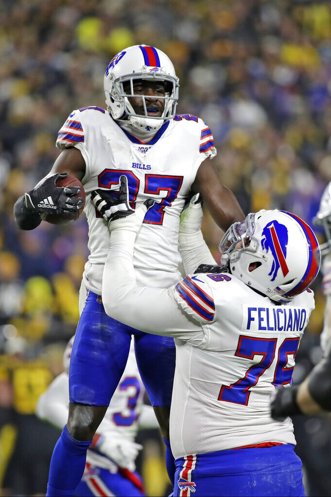 Buffalo Bills cornerback Tre'Davious White (27) celebrates his interception with Jon Feliciano during the first half of an NFL football game against the Pittsburgh Steelers in Pittsburgh, Sunday, Dec. 15, 2019. (AP Photo/Don Wright)