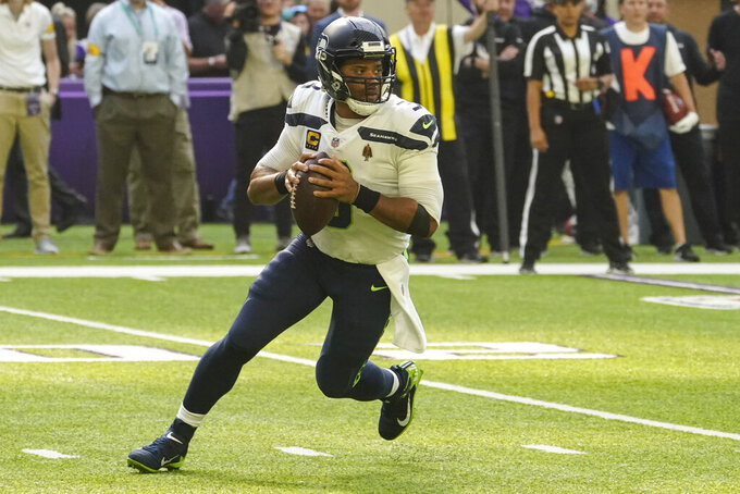 Seattle Seahawks quarterback Russell Wilson (3) drops back to throw against the Minnesota Vikings in the first half of an NFL football game in Minneapolis, Sunday, Sept. 26, 2021. (AP Photo/Jim Mone)