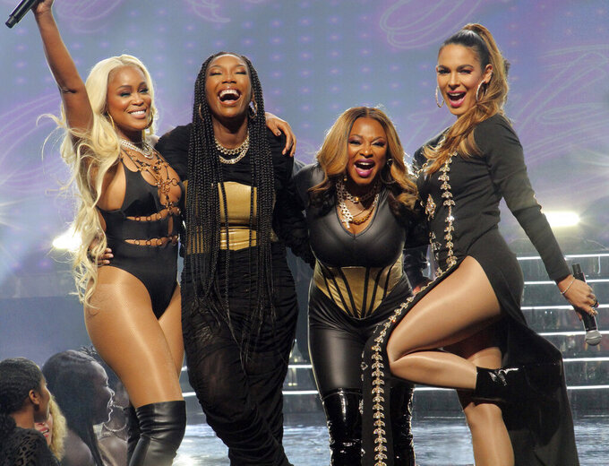 """This image released by ABC shows, from left, Eve, Brandy, Naturi Naughton and Nadine Velazquez in a scene from the pilot episode of """"Queens.""""  (Kimberly Simms/ABC via AP))"""