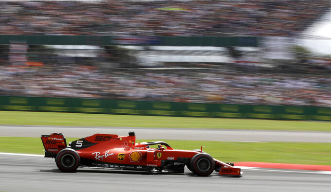 Ferrari driver Sebastian Vettel of Germany steers his car during the British Formula One Grand Prix at the Silverstone racetrack, Silverstone, England, Sunday, July 14, 2019. (AP Photo/Luca Bruno)