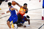 Utah Jazz's Donovan Mitchell (45) is fouled by Denver Nuggets' Jerami Grant (9) during the second half of an NBA basketball first round playoff game Sunday, Aug. 23, 2020, in Lake Buena Vista, Fla. (AP Photo/Ashley Landis, Pool)