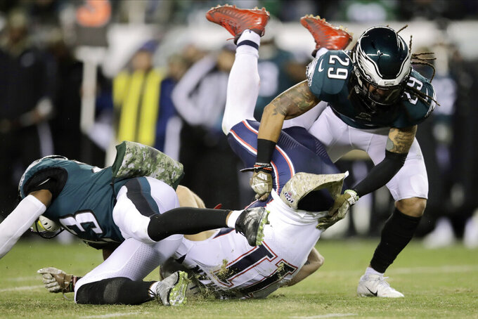 New England Patriots' Julian Edelman (11) is tackled by Philadelphia Eagles' Rodney McLeod (23) and Avonte Maddox (29) during the first half of an NFL football game, Sunday, Nov. 17, 2019, in Philadelphia. (AP Photo/Matt Rourke)
