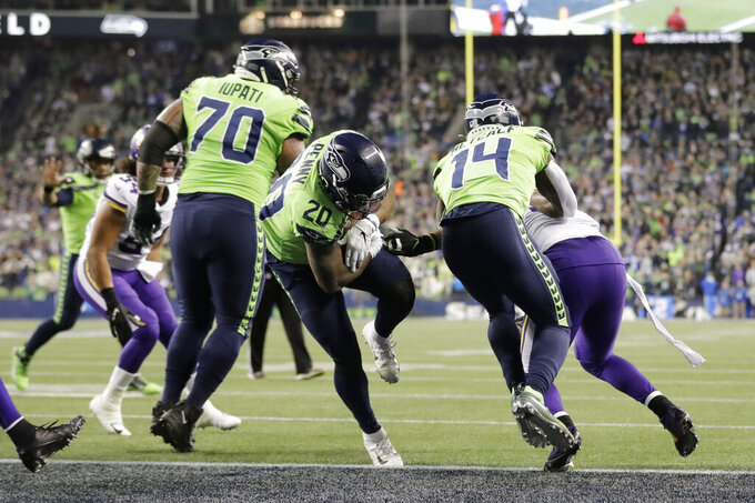 Seattle Seahawks' Rashaad Penny (20) scores a touchdown on a 1-yard run against the Minnesota Vikings during the second half of an NFL football game, Monday, Dec. 2, 2019, in Seattle. (AP Photo/Ted S. Warren)