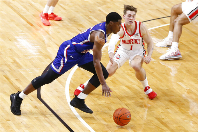 UMass-Lowell's Allin Blunt, left, drives to the basket as Ohio State's Jimmy Sotos defends during the second half of an NCAA college basketball game Sunday, Nov. 29, 2020, in Columbus, Ohio. (AP Photo/Jay LaPrete)