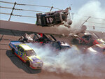 FILE - In this April 28, 1996, file photo, NASCAR driver Ricky Craven (41) flips into the catchfence in turn one of the Talladega Superspeedway during the Winston Select 500, in Talladega, Ala. Also visible are Derrike Cope (12), Geoff Bodine (7), Brett Bodine (11), Jeff Gordon (24), and Jeff Purvis (44). The ever-present air of unpredictability at Talladega Superspeedway is even more pronounced than usual this weekend, with NASCAR having replaced the horsepower-sapping restrictor plates. (AP Photo/Ashley Fleming, File)